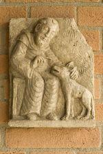 S. Francisco e o lobo, escultura em pedra